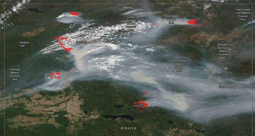 The northern part of Canada's Alberta province was pockmarked with wildfires on May 29, as seen in this natural-color satellite image collected by the Moderate Resolution Imaging Spectroradiometer (MODIS) aboard the Terra satellite