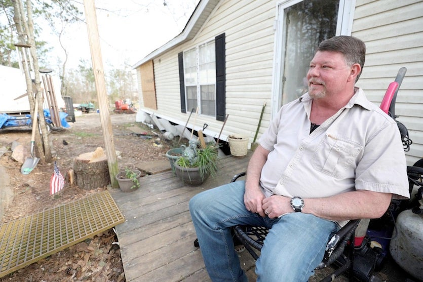 Lee County Road 721 resident David Kelley sits on his front porch on Wednesday, March 14, 2019, after a devastating tornado on March 3.