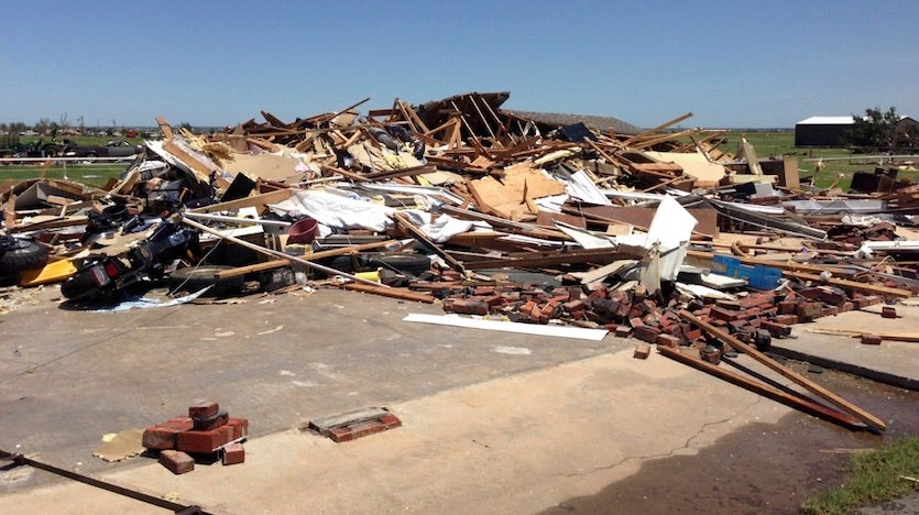 This photo shows EF3 damage from the tornado of May 31, 2013, to a house near the intersection of Rother Road and SW 15th Street, or about 6 miles south-southeast of El Reno, OK in Canadian County. All of the walls of the house collapsed. Image credit: NW