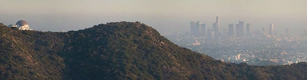 Los Angeles, CA, shrouded in late-afternoon smog as viewed from the Hollywood Hills