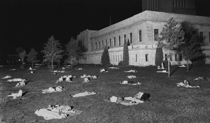 Residents of Lincoln, Nebraska spend the night on the lawn of the state capital on July 25, 1936