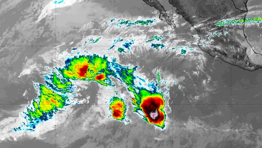 Enhanced infrared image of a broad area of disturbed weather associated with an upper-level low well to the west of Mexico at 2035Z (3:35 pm EST) Friday, January 4, 2019
