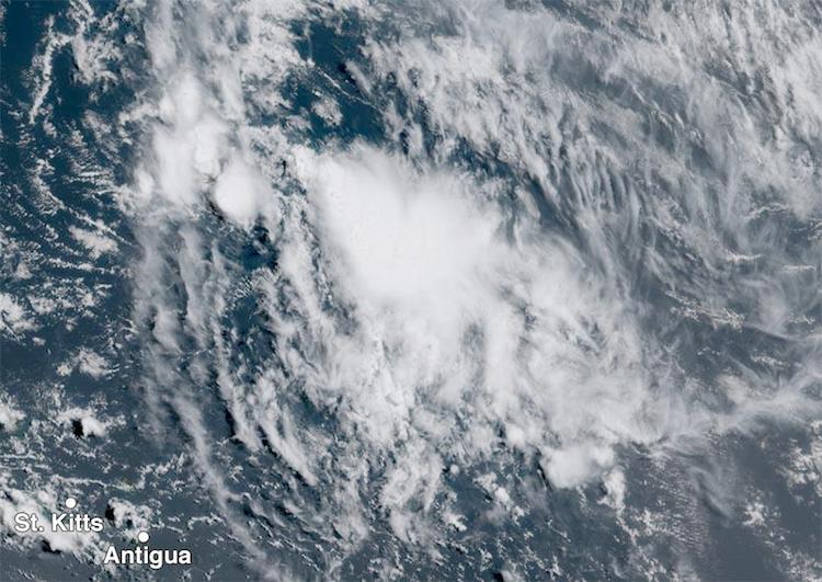 Visible satellite image of 92L, 1615Z 8/18/2017